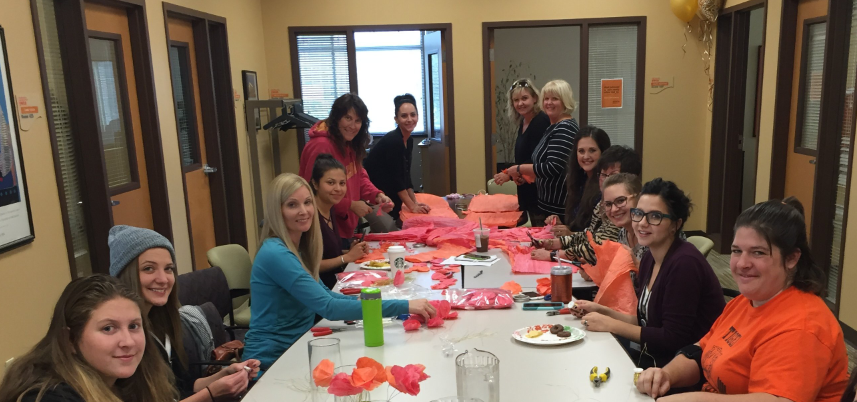 Volunteer Craft Party for Women of Achievement Luncheon.