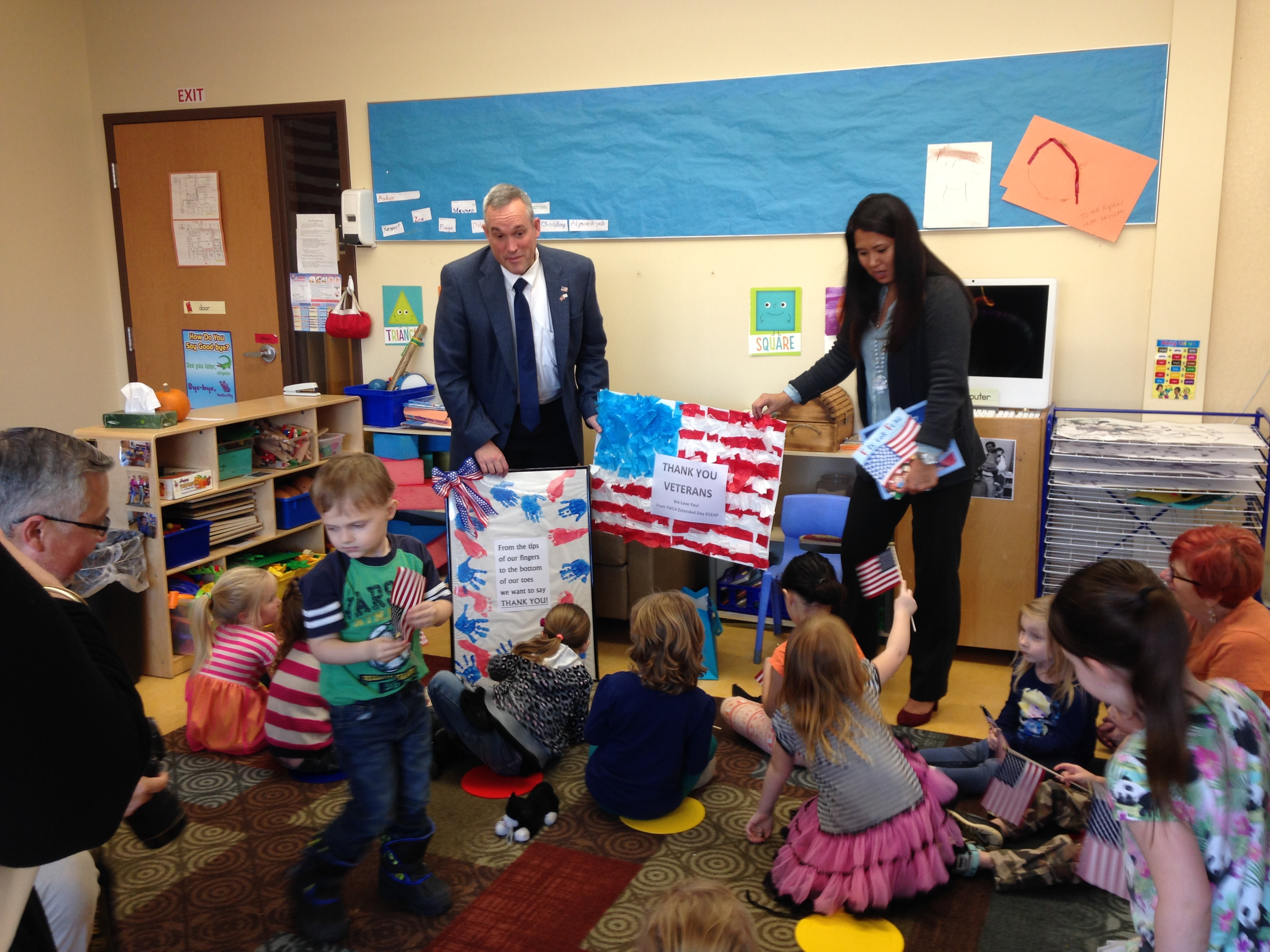 Colonel Newberry reads to YWCA pre-schoolers and celebrates Veterans Day
